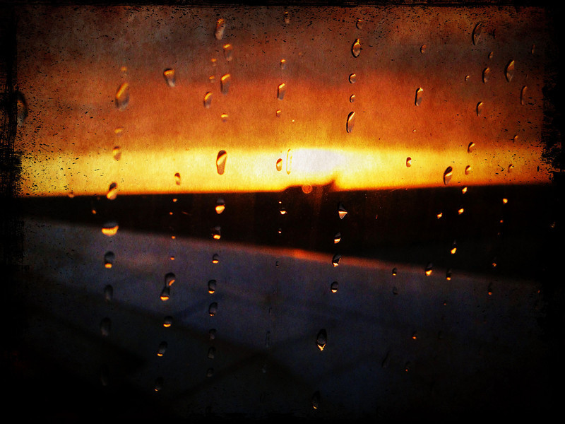 Sun rising with rain at SFO