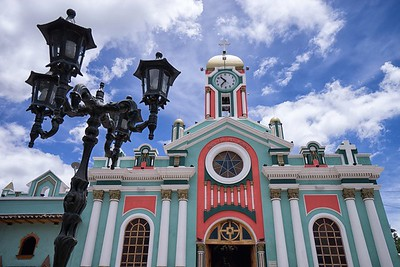 March 12, 2017 Vilcabamba, Ecuador: colurful church facade in the popular tourist destination town in the Andes
