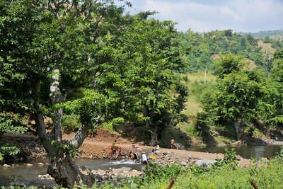 Washing and bathing near villages in rural India in the state of Maharashtra.