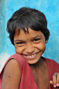 Portrait of a shy young girl in her village. Villages in rural India in the state of Maharashtra.