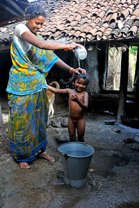 Bathing in a village. Villages in rural India in the state of Maharashtra.