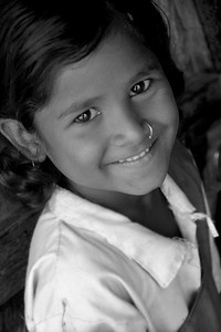 Portrait of a young girl in her village. Villages in rural India in the state of Maharashtra.
