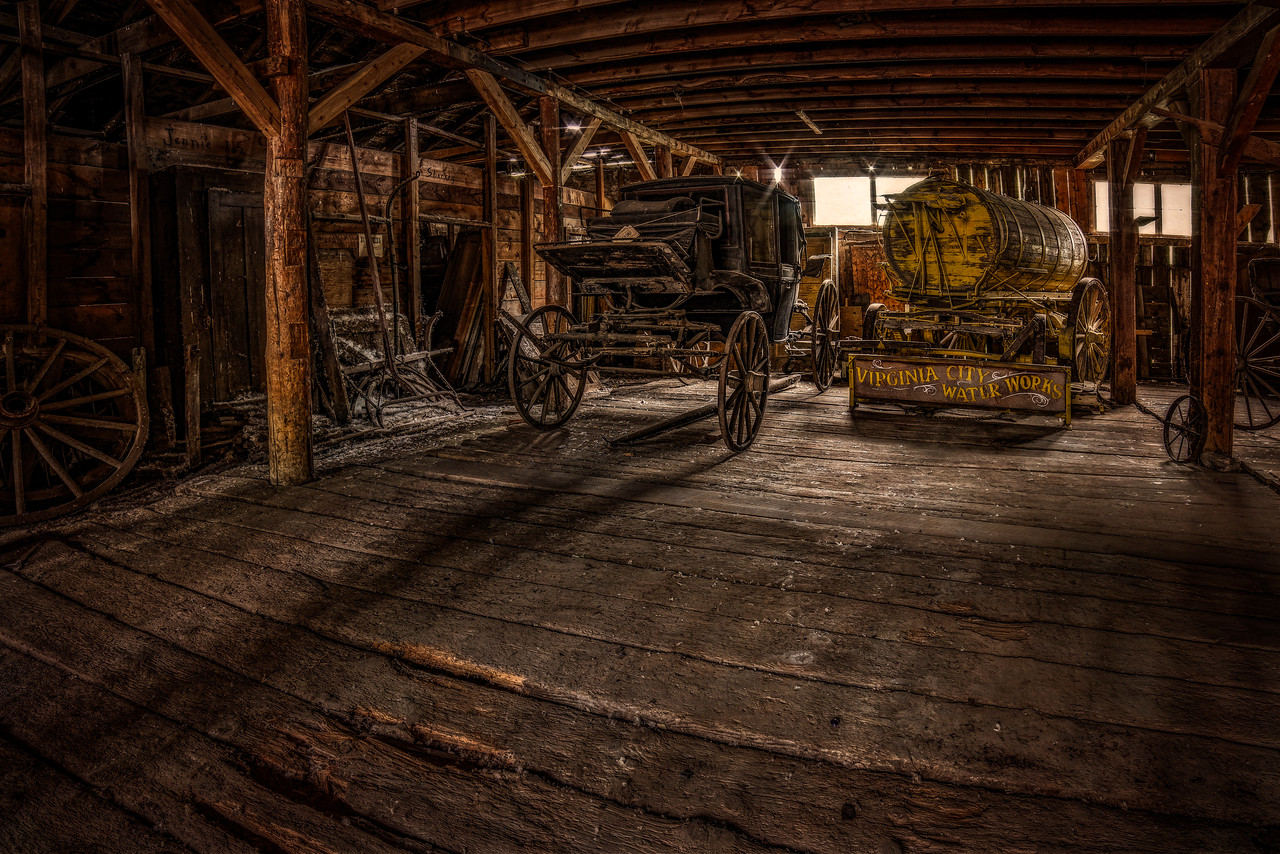 old west wagons in a barn.