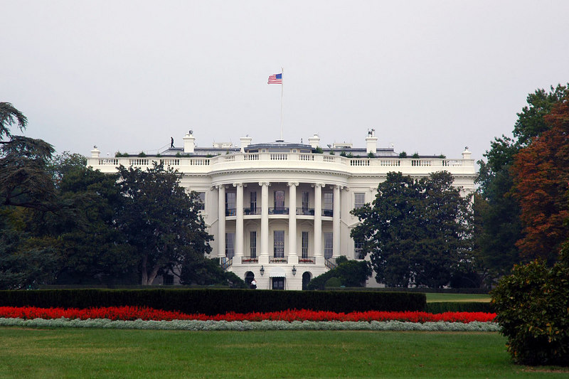 A closer view of the White House. There is a guard on the left side of the roof.