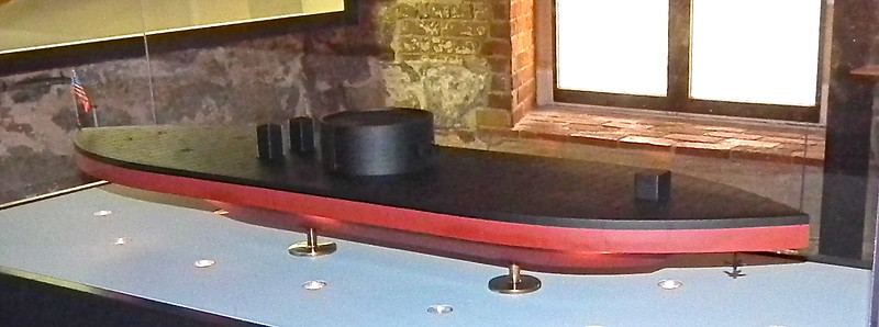 """USS Monitor - Casemate Museum, Fort Monroe - Hampton, VA<br /> Built in Brooklyn, NY and commissioned February 1862. It is 179' long and 41'6"""" (beam) by 10'6"""" (draft). Armament: Two 11"""" smoothboares (Dahlgrens). Armor: 8"""" turret and pilothouse, 4.5"""" hull, 1"""" deck, all with timber backing. Speed: 8 knots"""