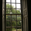 Looking out a window in a historical home in Colonial National Historic Park in Virgina.