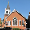 Trinity United Methodist Church - Historical Orange, Virginia - 9/22/12<br /> Built in 1892, the church is an L-shaped brick structure.  The building reflects Gothic Revival styling in its ponted arches, leaded glass transoms and rose windows.