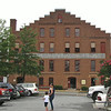 One of Many Warehouses Converted Into Furniture Outlets - Farmville, VA<br /> Set amidst beautiful, rustic buildings of generations gone by, Green Front's furniture-filled, renovated tobacco warehouses are set against a backdrop of quaint, historic Farmville, Virginia. Downtown Farmville with its welcoming atmosphere and obvious Southern charm make this a pleasurable shopping excursion.