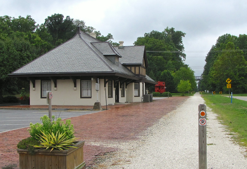 N&W Passenger Train Station - Farmville, VA<br /> Looking west from Appomattox Street at the former N&W passenger station.  During the steam era there was a water tank were the red caboose is located.  At one time there were also two sidings located to the right of the mainline.   The station began serving the traveling public on April 29, 1903.  Amtrak's Mountaineer traversed the line from March 25, 1975 to September 30, 1979.