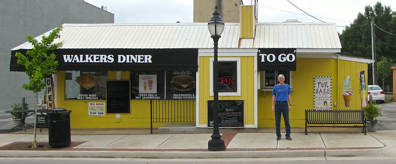 Randal in Front of Walker's Diner - Farmville, VA<br /> On January 27, 1989, the Walkers bought town lot 200208 from Allen and Dorothy McNamee Fore (DB 28/257). For the first time in 34 years, the owner of the diner was also the owner of the land upon which it sat.  After nearly 26 years as Walker's Diner, the Walkers had built their little 15-stool diner into a local legend, but it was time to give it up.
