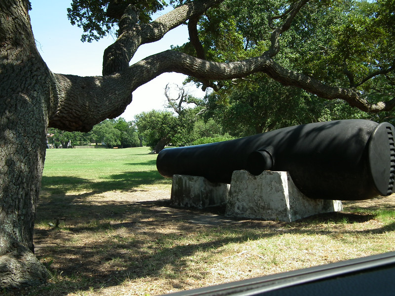 Lincoln Gun Next to an Awesome Tree - Fort Monroe - Hampton, VA<br /> Cast in 1860, this was the first 15-inch rodman gun.  Its range was more than 4 miles. Weight of the projectile was over 300 lbs.  During the Civil War it was used to bombard Confederate batteries on Sewells Point.  The gun was named for President Lincoln in March 1862.