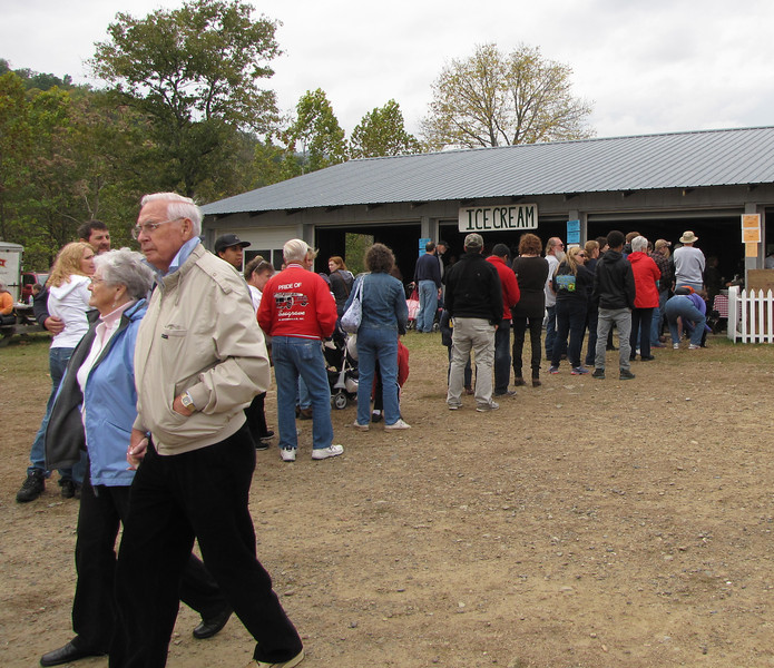 Waiting For Ice Cream - Graves Mountain Apple Harvest Festival - 10/19/13<br /> I thought it odd that it was such a chilly day and people were still lined up for ice cream … but then I'm not a fan of ice cream.  I like the contrast at the bottom left of the photo:  Notice the older couple walking holding hands and the younger couple behind hugging.  Awwwhhh.