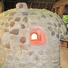 """Side View of the Red Hot Furnace - Historic Jamestown National Park, VA  10-22-10<br /> Glass was in demand in 17th-century England, and its manufacture required highly skilled craftsmen.  In 1608, German glassmakers, referred to as Dutchmen by John Smith, arrived in the Second Supply and successfully completed a """"tryle of glass"""" at James Fort.  A glasshouse was constructed a mile from James Towne where there was plenty of sand for making glass and timber for fueling the furnaces.  The glasshouse measured approximately 37x50 feet and sheltered three furnaces and one kiln built of river cobbles."""