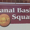 Signage at Canal Basin Square - E. Main St. - Scottsville, VA  1-6-13<br /> In the 1700s Scottsville was one of many agricultural communities along the James River.  Toward the end of the century, as river commerce increased, Scottsville became a busy trading center and an overnight stop for boats carrying tobacco and other goods to Richmond markets.  Scottsville's importance as a river port grew in the 19th century during the time of the Kanawha Canal.  In the 1700s Scottsville was one of many agricultural communities along the James River.  Toward the end of the century, as river commerce increased, Scottsville became a busy trading center and an overnight stop for boats carrying tobacco and other goods to Richmond markets.  Scottsville's importance as a river port grew in the 19th century during the time of the Kanawha Canal.