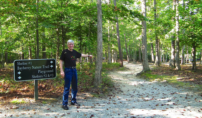 """Randal Points The Way To The Trail - Waller Mill Park - Williamsburg, VA We took the Bayberry Trail since we had <a href=""""http://www.thenatureinus.com/2012/07/i-found-new-adventure-letterboxing.html""""><b>letterboxing clues</b></a> to find on this trail."""