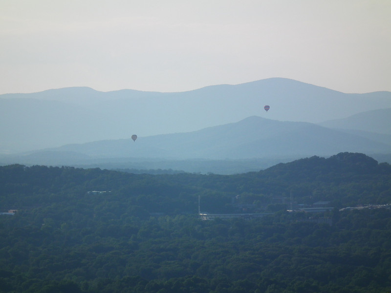 Hot Air Balloons Against The Blue Ridge Mountains - The Wildlife Center Benefit at Carter Mountain Orchard, Charlottesville, VA  6-9-12<br /> Since it was getting close to sunset you could see why the Blue Ridge Mountains were named that.
