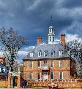 The Governor's Palace of Colonial Virginia in Williamsburg under a Spring sky threatening to rain.
