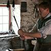 Frontier Culture Museum's Irish blacksmith inspects his handiwork.