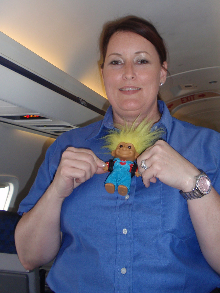 Day 1: Flight. Our stewardess, Elizabeth, with Spike, on our flight from hell. It was only her second time on the job. It took three tries to get to Norfolk.