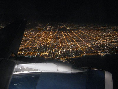 Returning back, the lights of Chicago twinkle