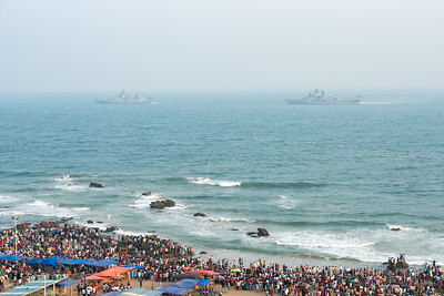 Large crowds at the Ramakrishna beach watching the preparations by the Eastern Naval Command, Visakhapatnam to celebrate the Navy Day on December 4. Marking the day that Indian Navy Missile Boats carried out a deadly attack on Karachi Harbour in the 1971 Indo-Pak war. RK Beach, Visakhapatnam (Vizag), Andhra Pradesh, India.
