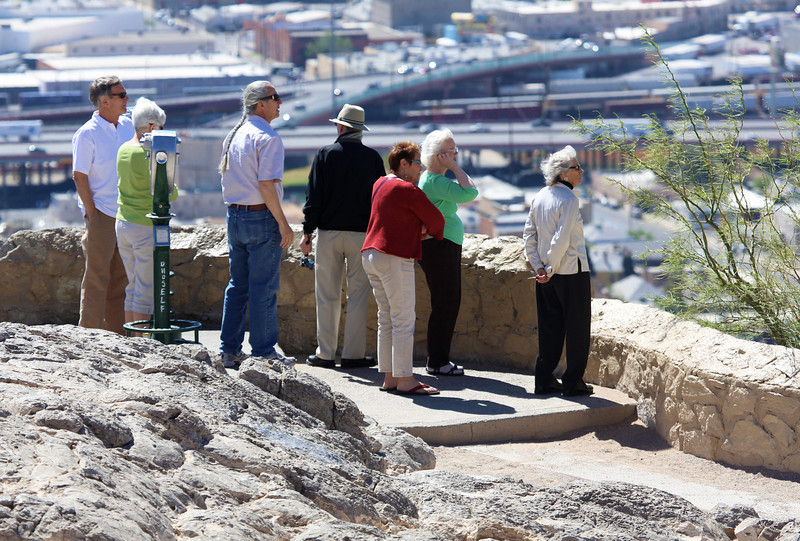 Jerry, Carolyn, Carol, and others, looking out over El Paso.