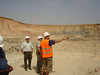 Sr, Geologist Pierre explains the geology of Taparko mine in the main open pit.