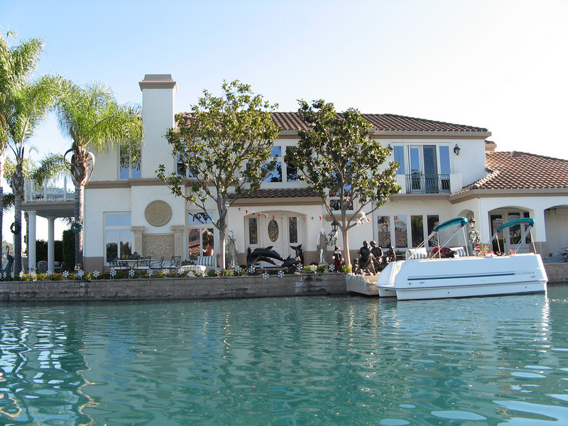 We started out the trip with a visit to my Aunt Barb who lives in Lake Forest, CA.  Her house, like this one, lines the shore of a man-made lake.  Everyone has an electric boat for tooling around on the water.