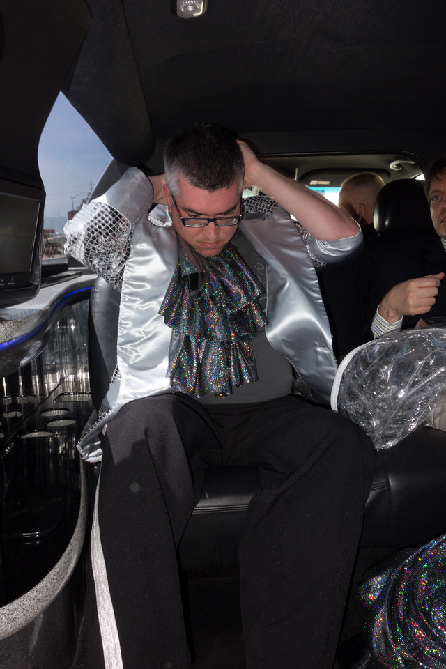 Warren dressing (as Liberace) in the limo on the way to renew his vows