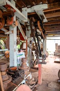 A belt driven grinder.