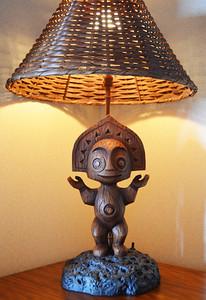 Disney's Bora Bora Bungalow - master bedroom tiki god lamp