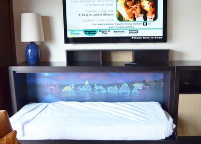 Disney's Bora Bora Bungalow - living room with fold down bed