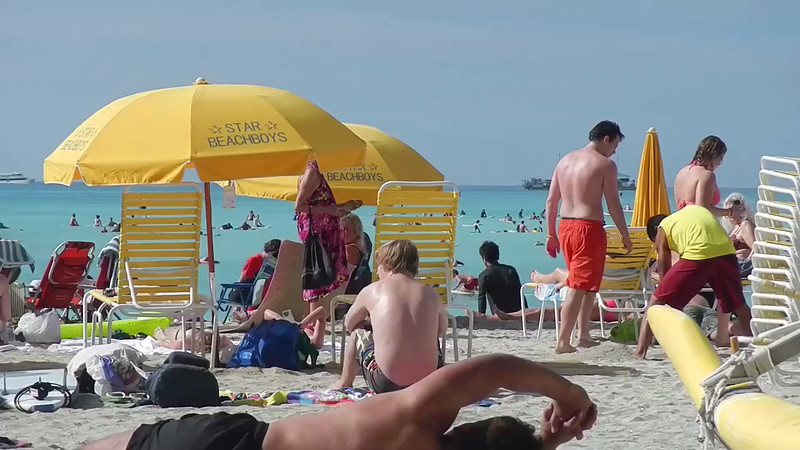 A view of the beach at Waikiki. The ship in the background is from one of the hotels. You pay for a water excursion, and the boat goes out to this location every morning, you do whatever you do on the anchored boat all day, then it returns to the hotel in the evening.