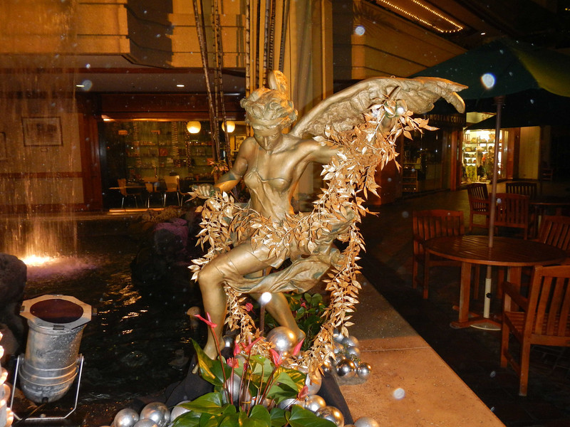 The waterfall/fountain in the Hyatt Regency in Waikiki had this permanent artwork along its side. Following photos show Christmas decorations.