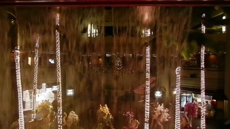 This is behind the waterfall fountain at the Hyatt Regency, looking out toward the street and the Christmas decorations.