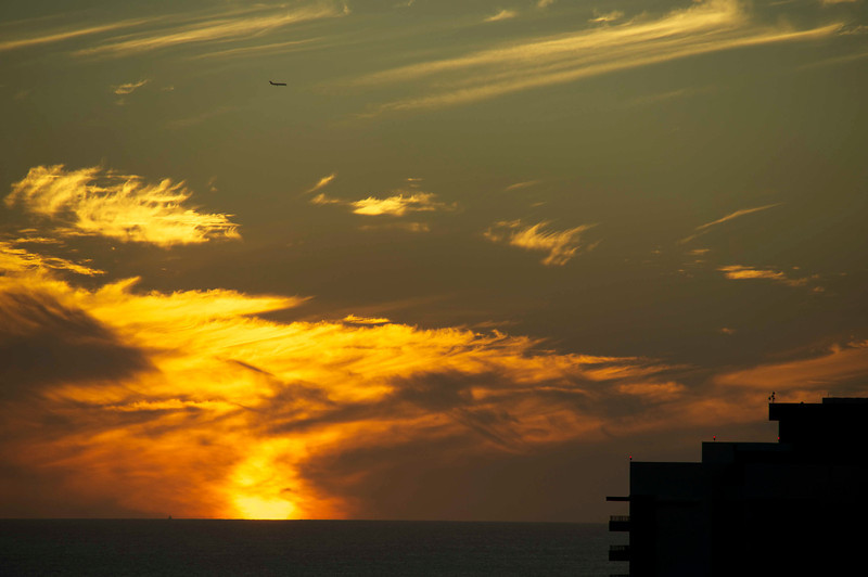 Our sunset view from the Aqua Bamboo Hotel let us watch planes approach the airport for landings.
