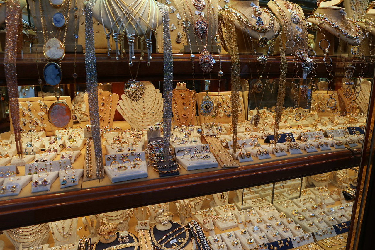 Gold and silver over the Arno.  Taking the plunge means dipping into your wallet for Euros.