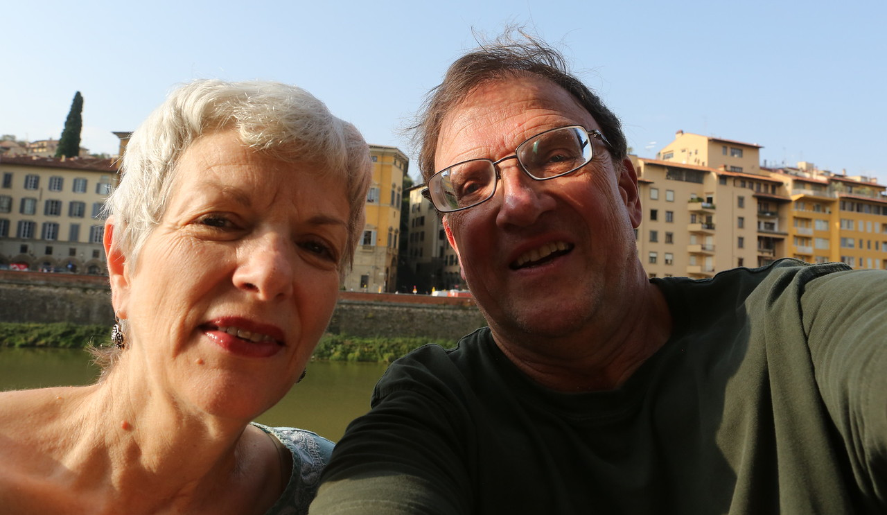 """Sarah and Kent take a """"selfie"""" with the Arno River in the background."""