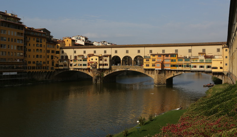 Ponte Vecchio spans the Arno river and is now famous for its silver and gold shops. Originally the bridge housed butcher shops that used the river as a convenient disposal system.