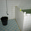 angrekk hotel bathroom showing the mandie and the hot water bucket