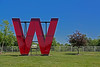 "The giant ""W"" came from the old Busch Stadium in St Louis.  They chose the W for Warm Springs."