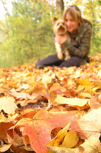 Picture of some leaves, with Natarsha and Mady in background