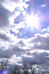 Clouds, sun, trees