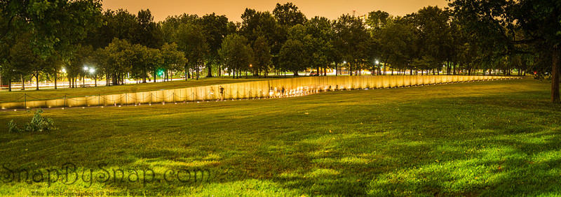 A night time panorama image of the Vietnam Veterans Memorial