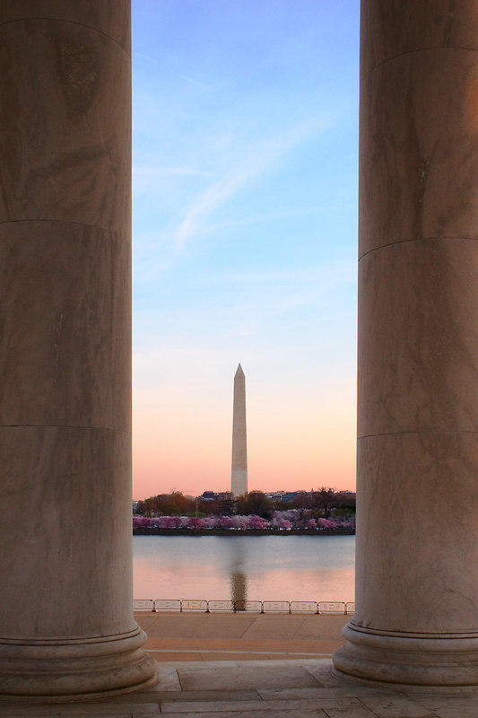 The Washington Monument in the early morning light from inside the Jefferson Memorial