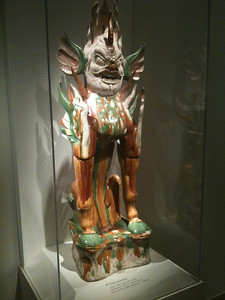 Tang Dynasty guardian of a tomb. Cream brown and green glaze over earthenware. Sackler.