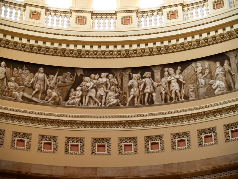 "A section of the 3D mural / sculpture that rings to ""Grand Rotunda"" just below the windows."