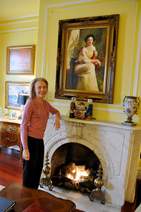 Marsha at one of the original Italian marble mantels.