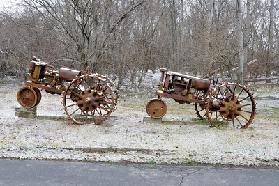 Old tireless tractors along the Inn's entranceway.