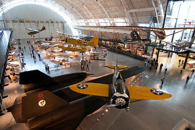 "SR-71 with the Boeing P-26 ""Peashooter"", a 1930's era US Army Air Corps fighter, overhead."